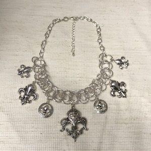 Stunning silver fleur de lis statement necklace